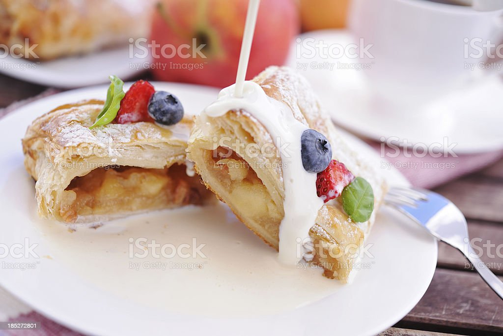 Apple strudel with vanilla sauce stock photo