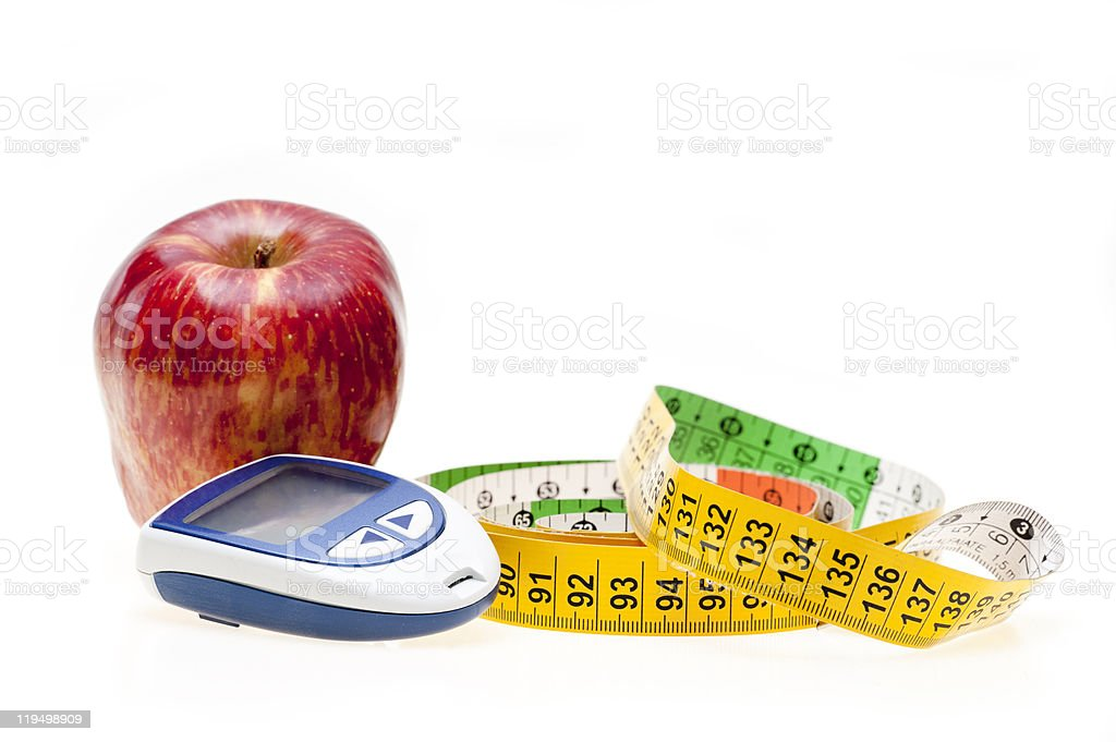 Apple, tape and glucometer royalty-free stock photo