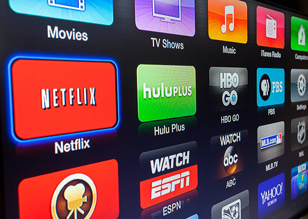 Apple TV interface Las Vegas, USA - January 06, 2014: A photo of the Apple TV interface being displayed on a LCD television screen. Apple TV is a digital media player developed and sold by Apple Inc.  netflix stock pictures, royalty-free photos & images