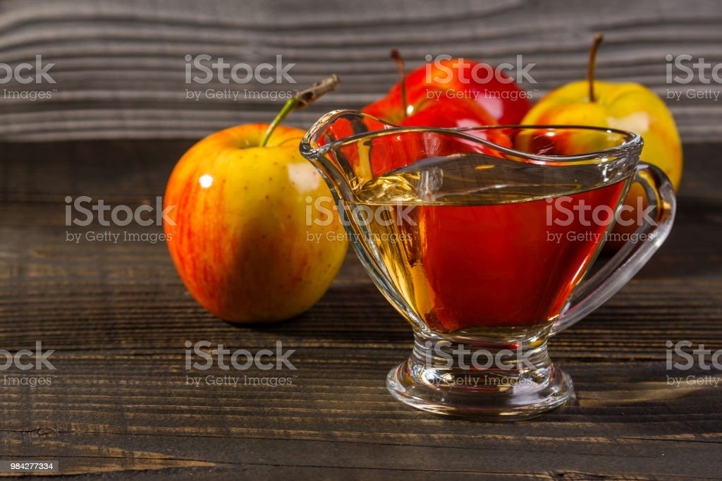apple vinegar on a wooden rustic background stock photo
