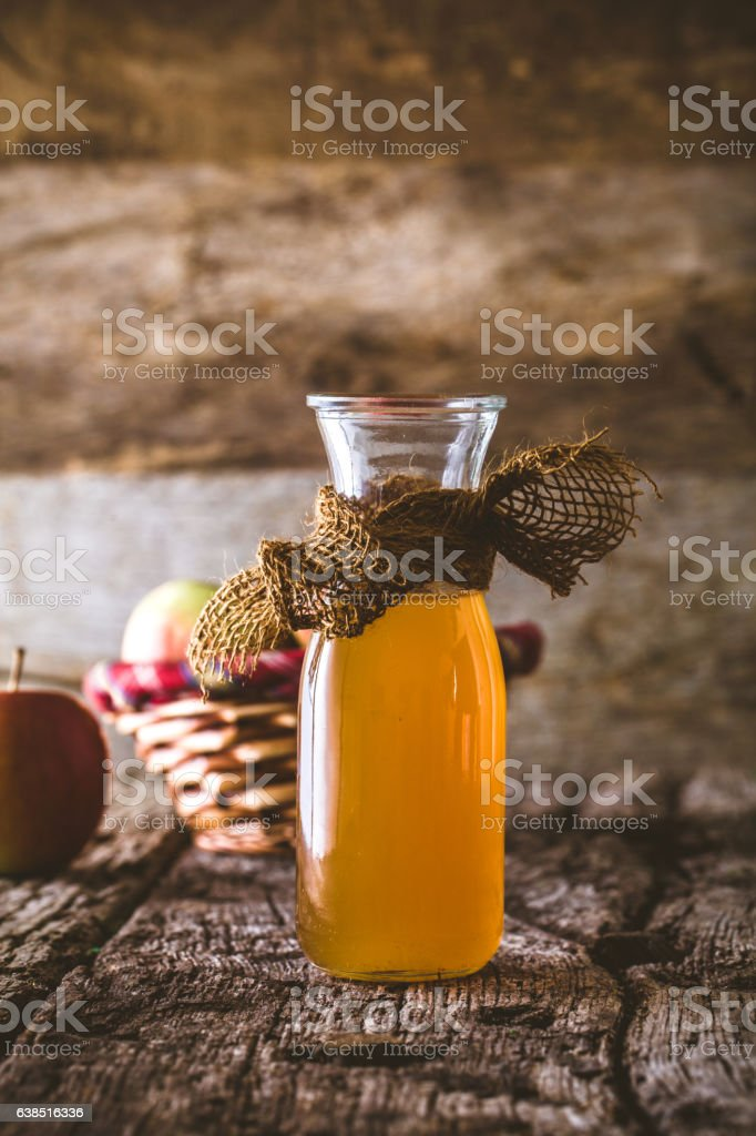 Apple vinegar on wood stock photo