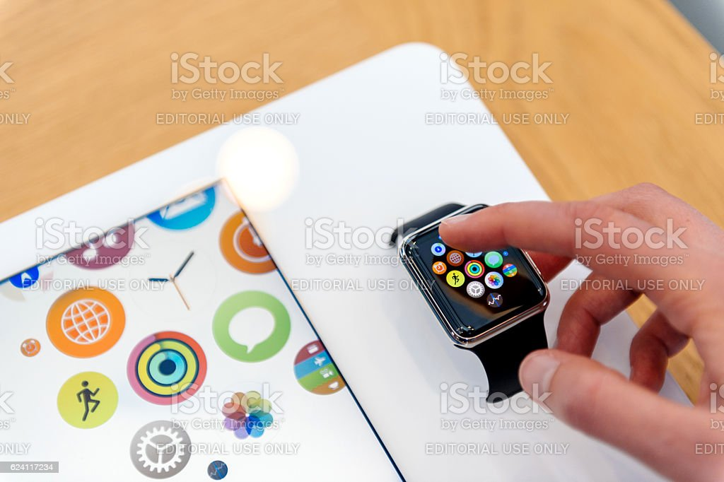 Apple Watch being tested by woman before buying stock photo
