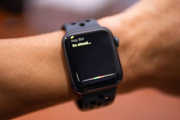 Apple Watch Nike+ Series 4 showing its screen with Siri, Apple's voice-activated digital assistant. stock photo