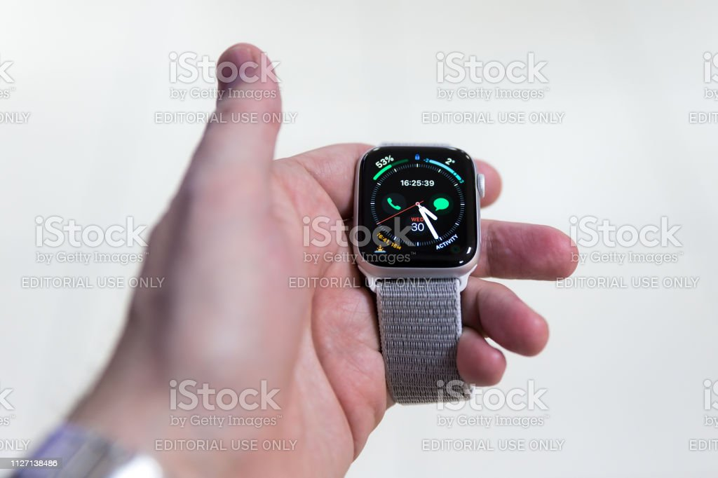 Apple Watch Series 4 is displayed in hand isolated on white...