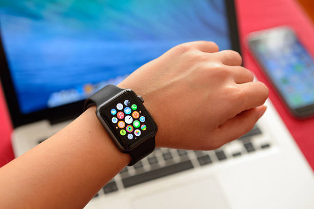 Apple Watch Sport with Apple computers stock photo