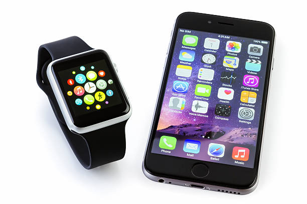 Apple Watch Sport with iPhone 6s on white stock photo