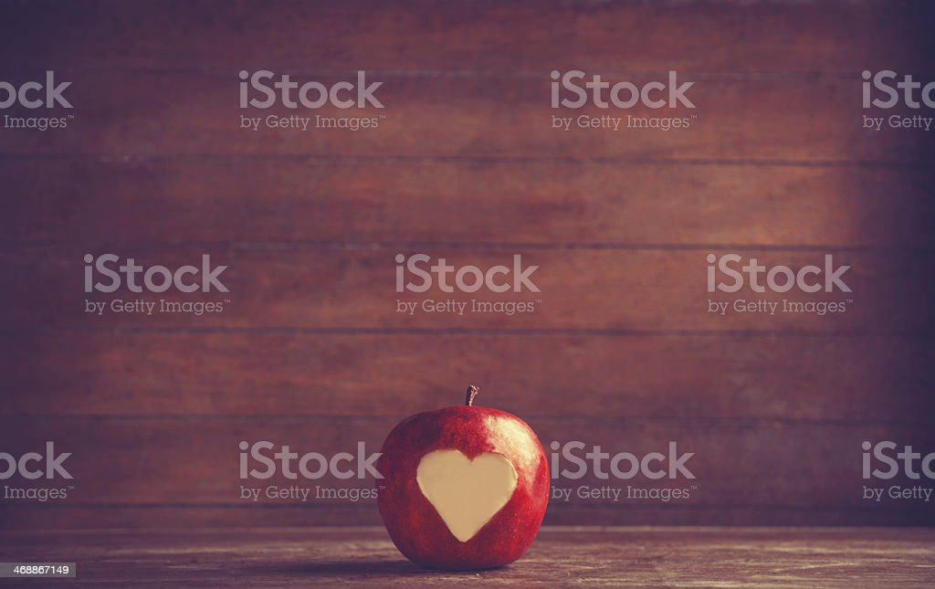 Apple with a heart cut into it stock photo