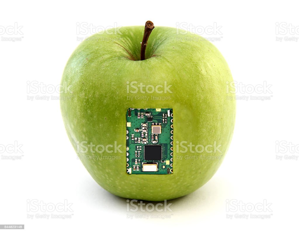 Apple with an integrated circuit stock photo