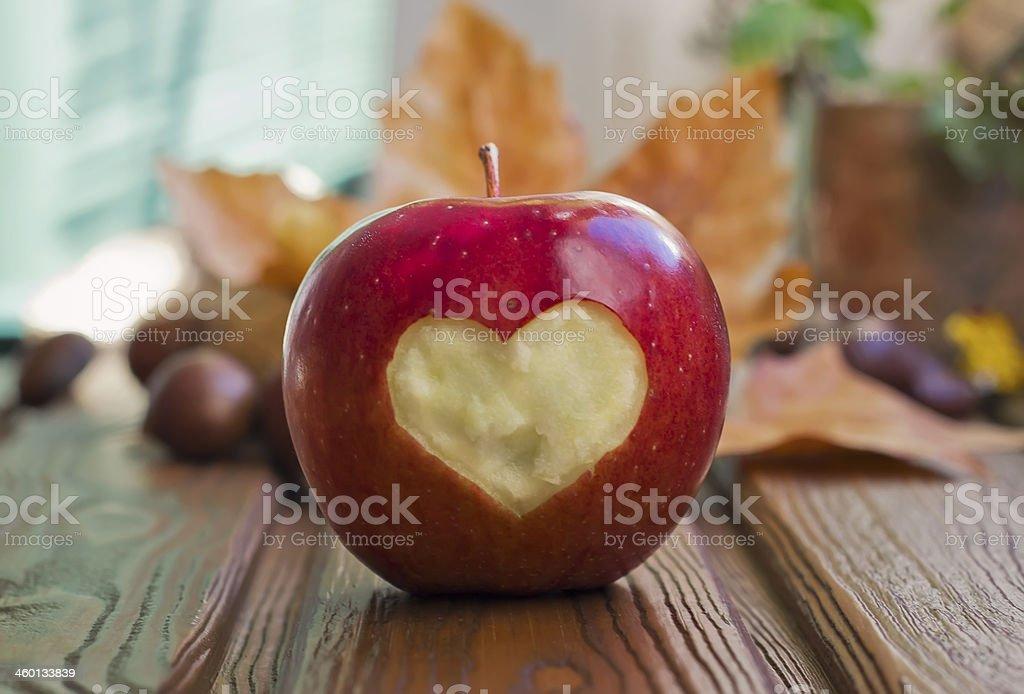 Apple with heart figure stock photo