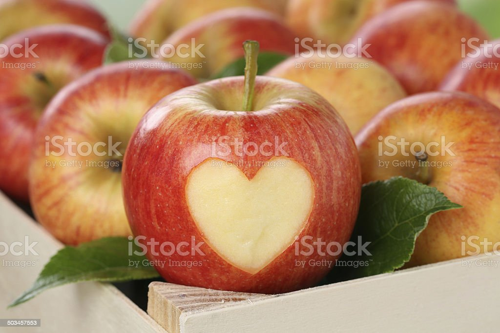 Apple with heart love topic stock photo