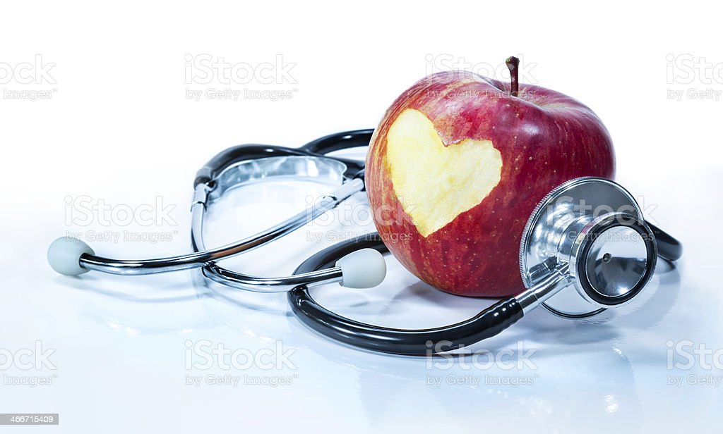 apple with stethoscope concept of love for health Alternative Medicine Stock Photo