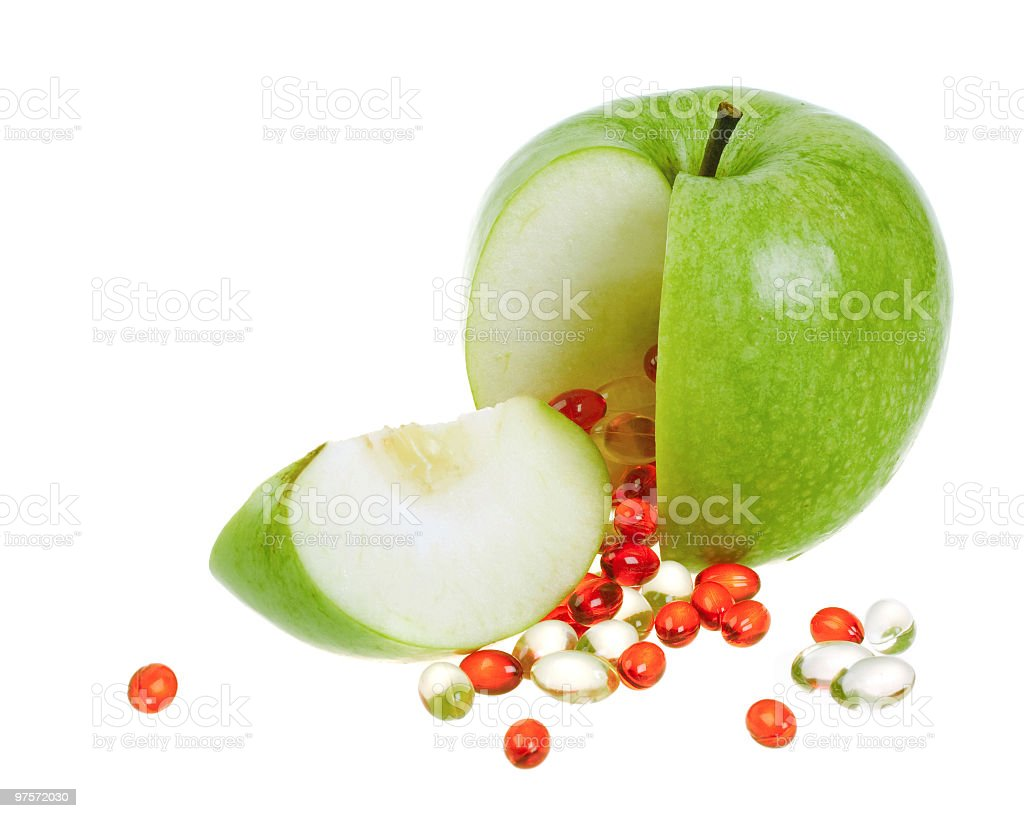 Apple with vitamin capsules royalty-free stock photo