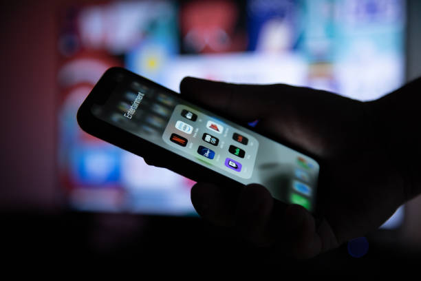 Apple xs smartphone in hand with group of streaming applications picture id1188224727?b=1&k=6&m=1188224727&s=612x612&w=0&h=4o6ti7arf m8 khcmpjqf33xzbaayum hmsssmsgjxq=