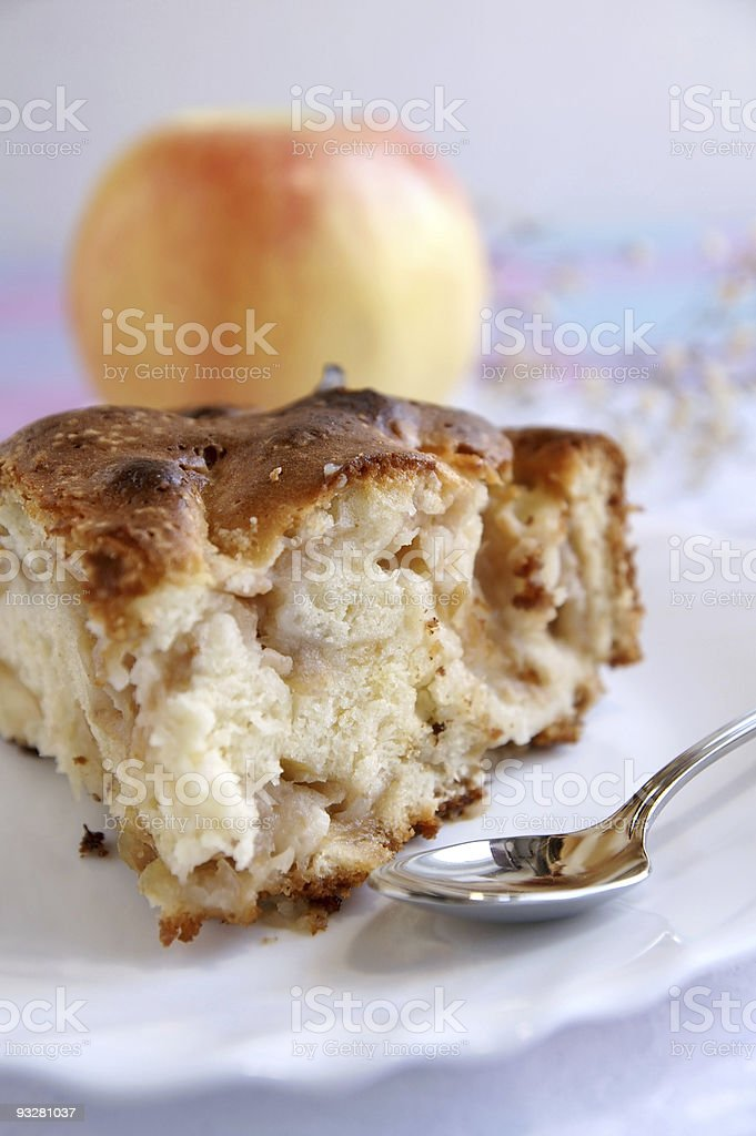 Apple-pie piece on a white table royalty-free stock photo