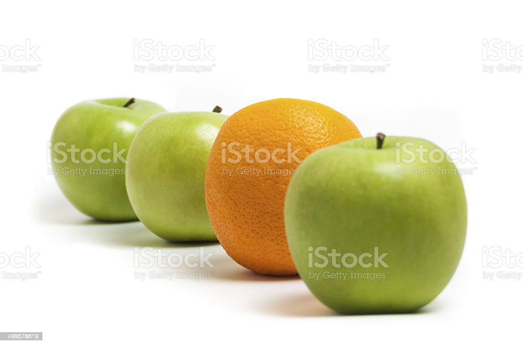 Apples and an orange stock photo