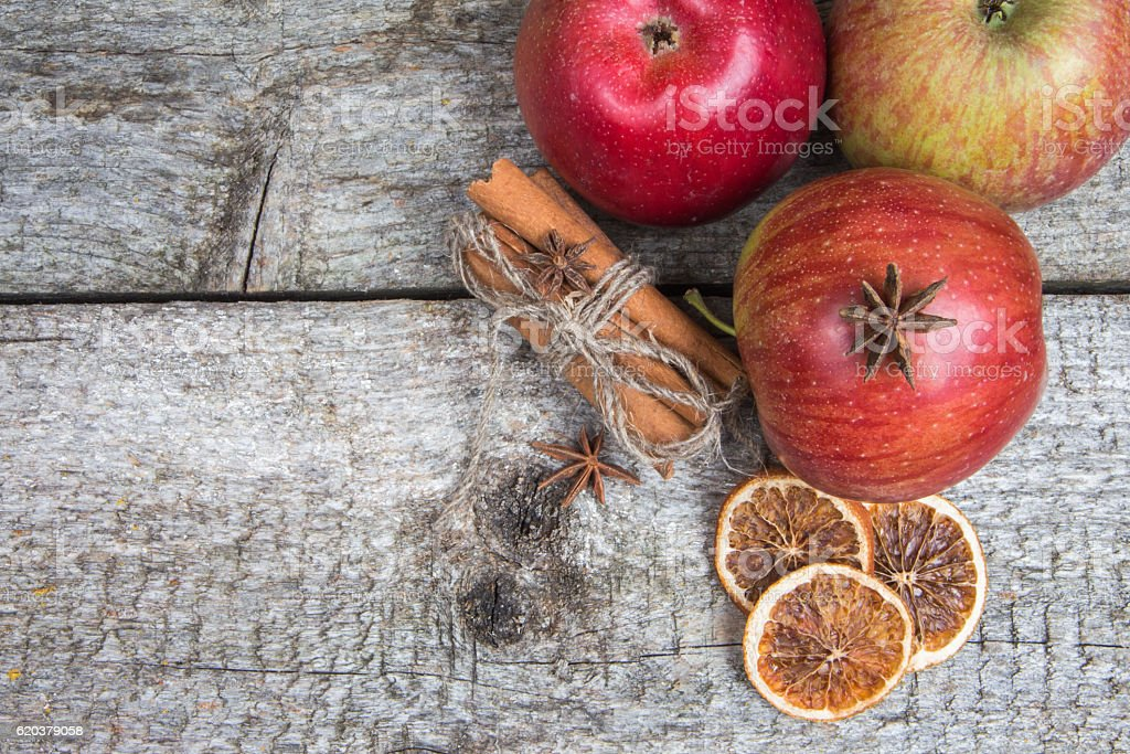 Apples and dried spices on rustic wooden background. Christmas holidays zbiór zdjęć royalty-free