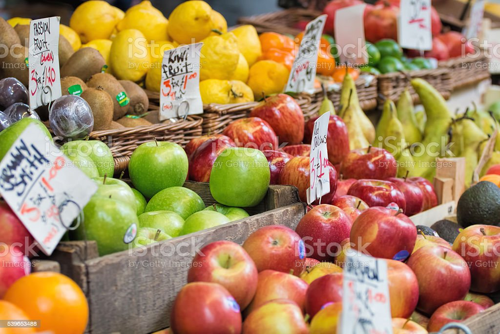Apples and other fruits for sale at market. stock photo