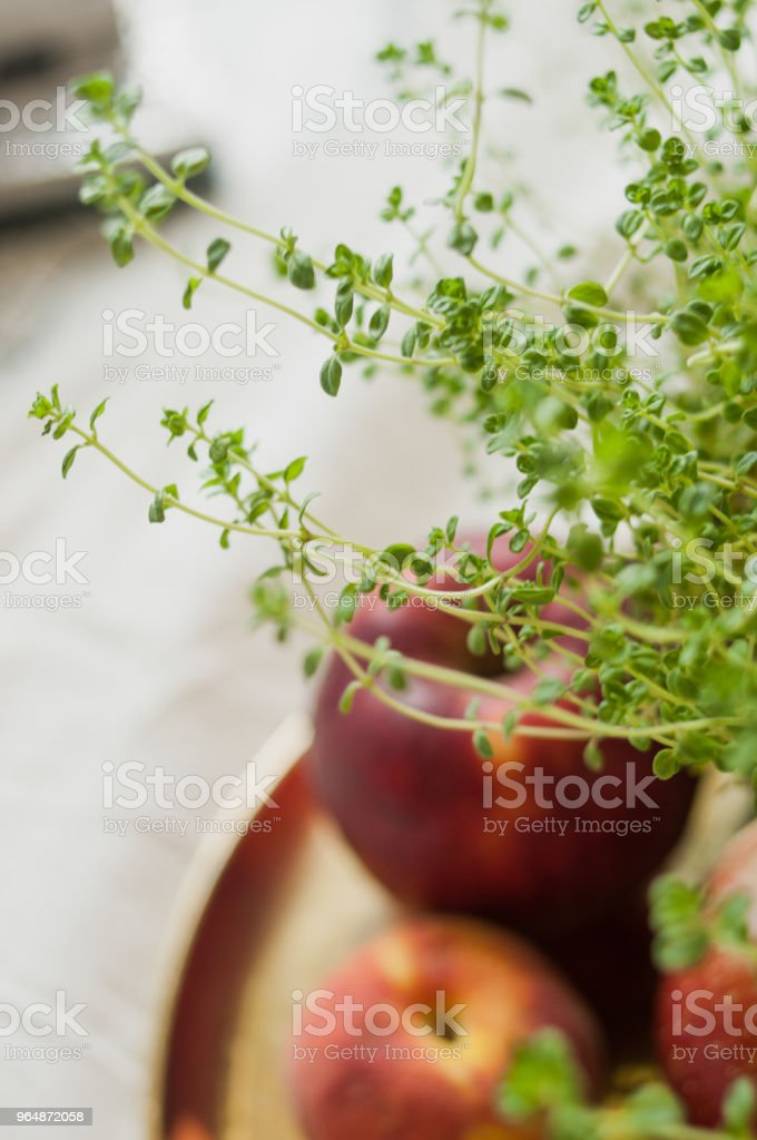 Apples and peaches with thyme on a golden dish blurry royalty-free stock photo