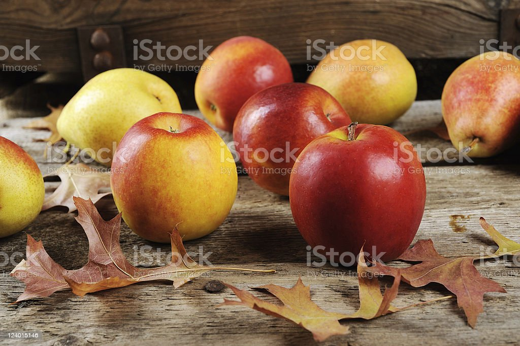 Apples and pears on a wooden board