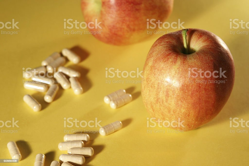 apples and pills stock photo