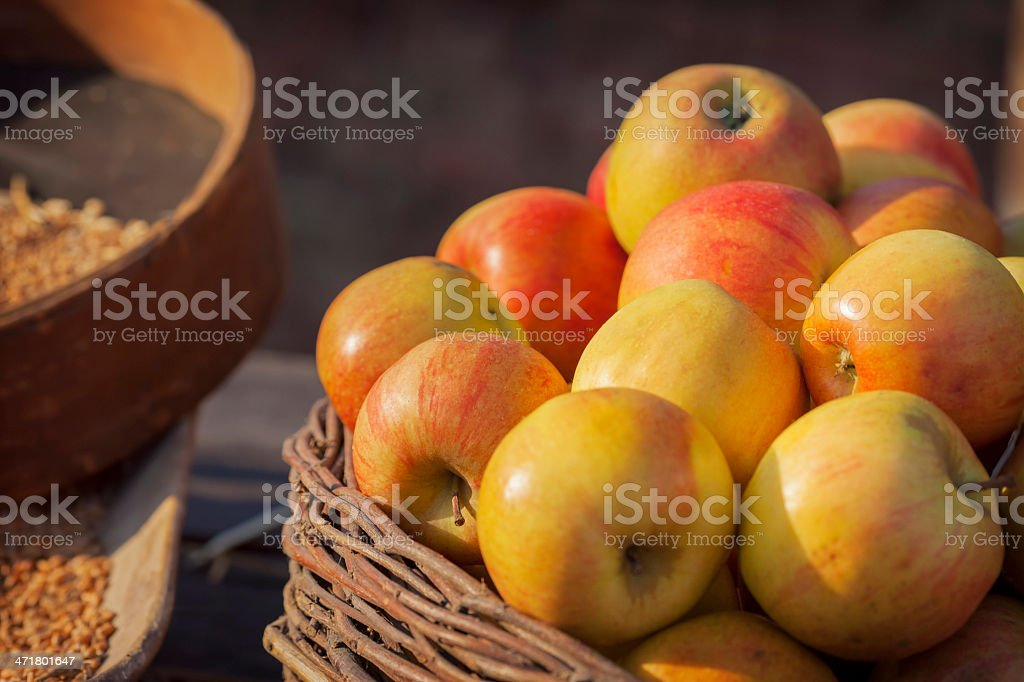Apples and wheat in basket. royalty-free stock photo