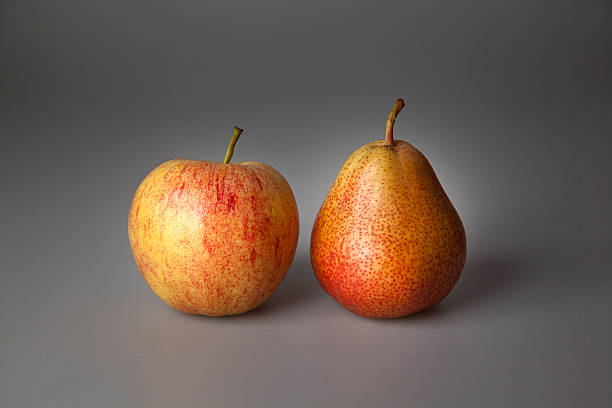 apples compare with pears stock photo