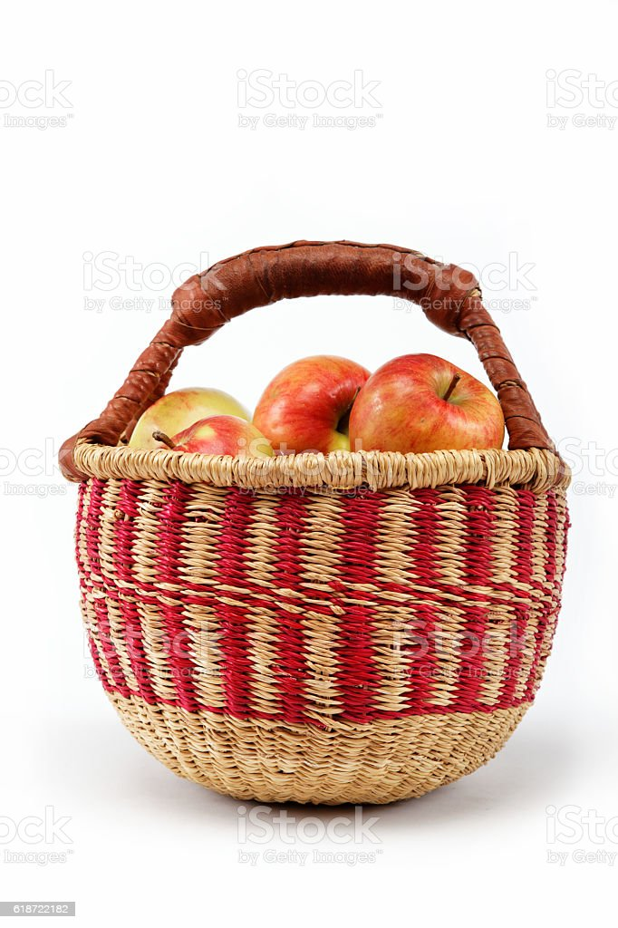 Apples in a basket on a white background. stock photo