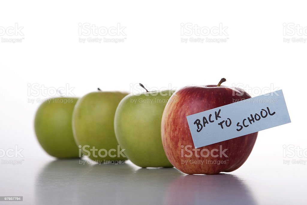 Apples in line to school royalty-free stock photo