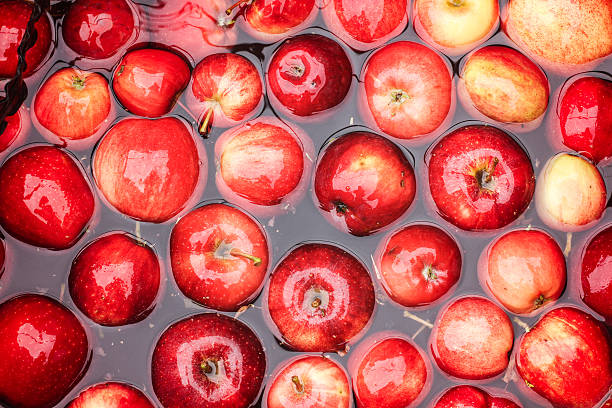 Apples in Water Apples in water, ready to be made in to cider hot apple cider stock pictures, royalty-free photos & images