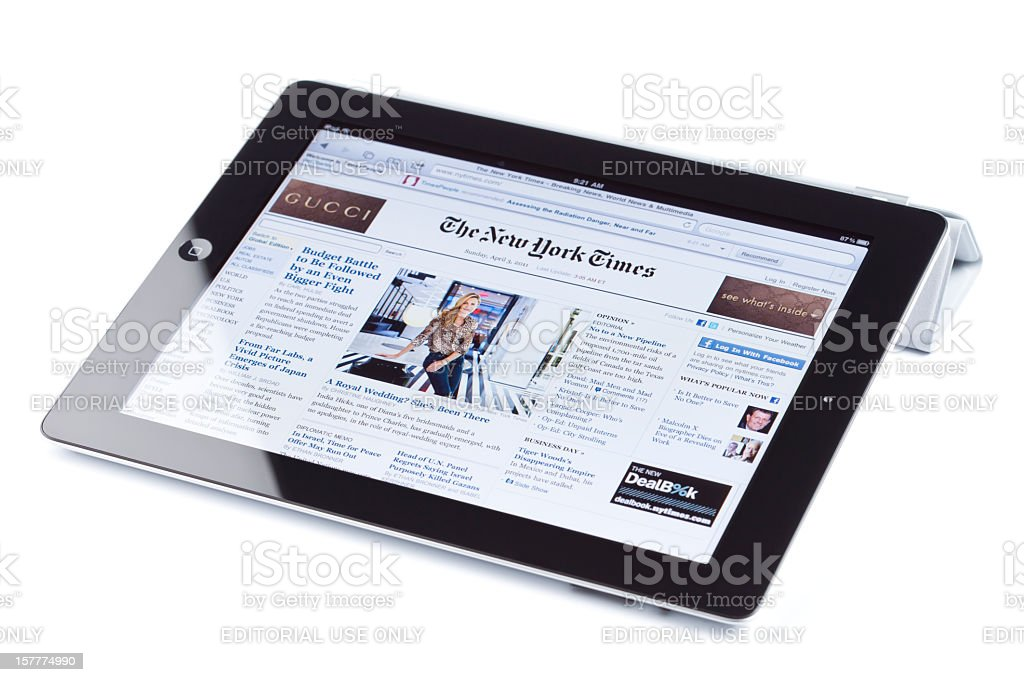 Apple's iPad2, isolated, showing The New York Times web site royalty-free stock photo