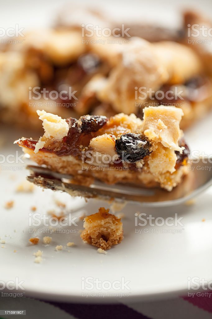 Apples, Nuts and Raisins Tart Mouthful on Fork stock photo
