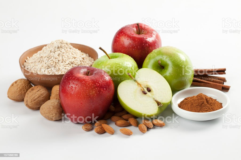 Apples, oat flakes, cinnamon, nut and almond composition royalty-free stock photo