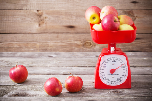 apples on red scales