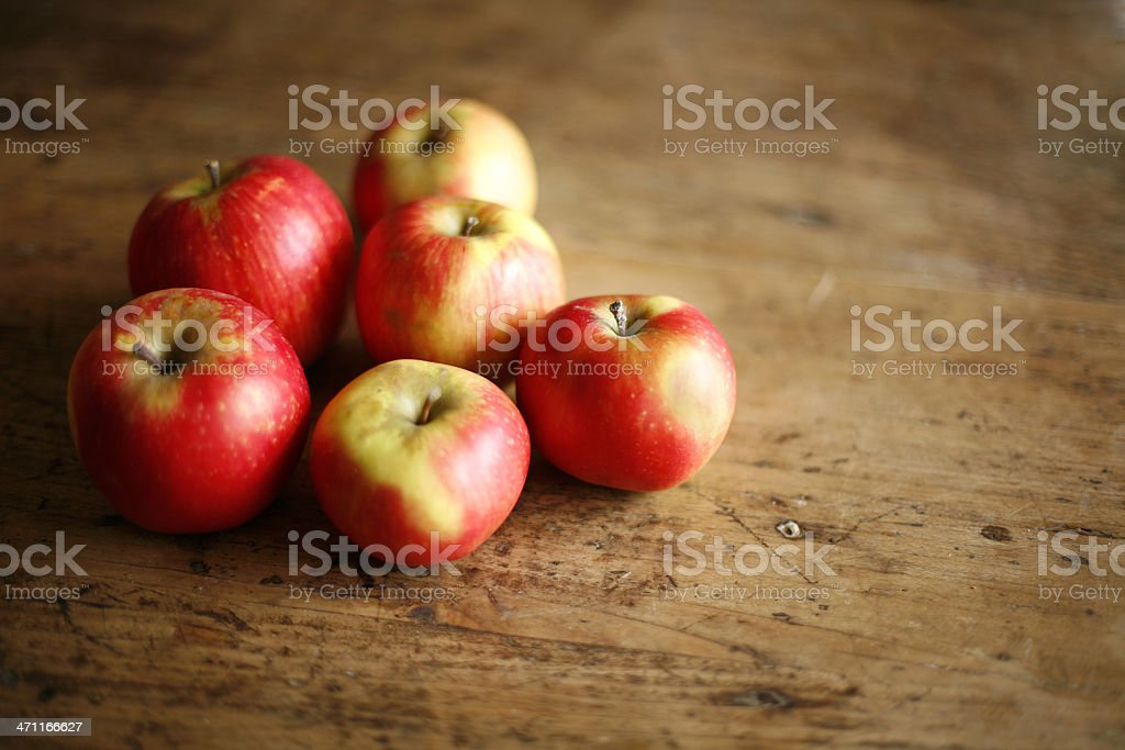 apples on rustic table royalty-free stock photo