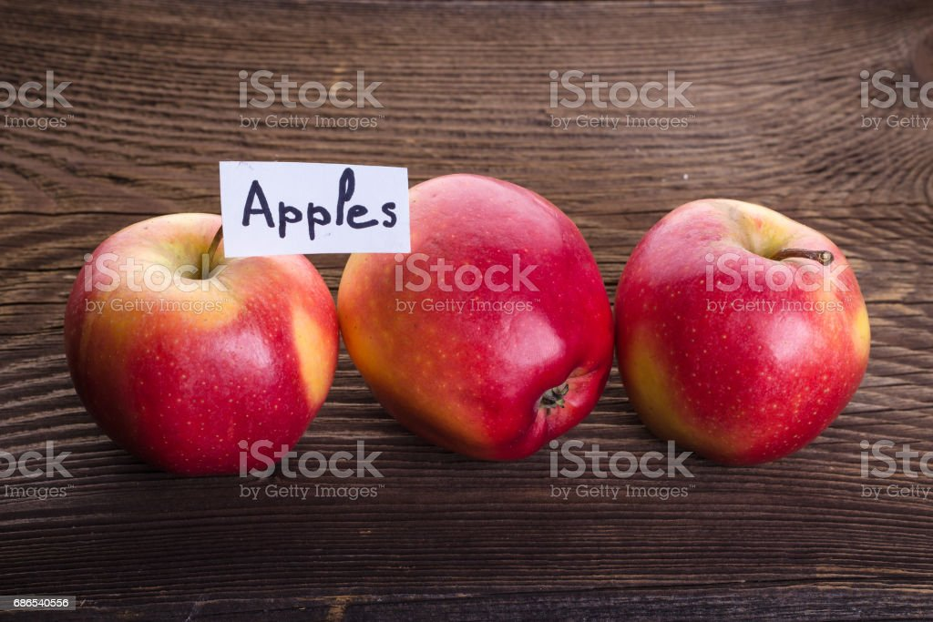 Apples on wooden background royalty free stockfoto