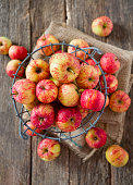 apples on wooden surface