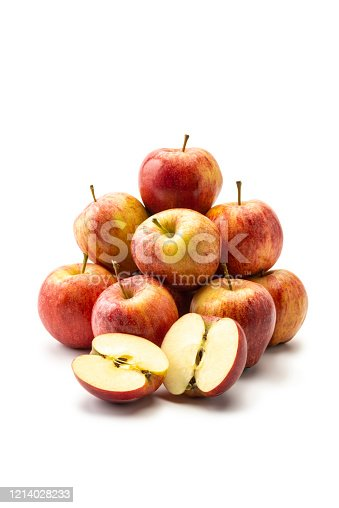 Pile of Fresh Apples on white background. One apple sliced.