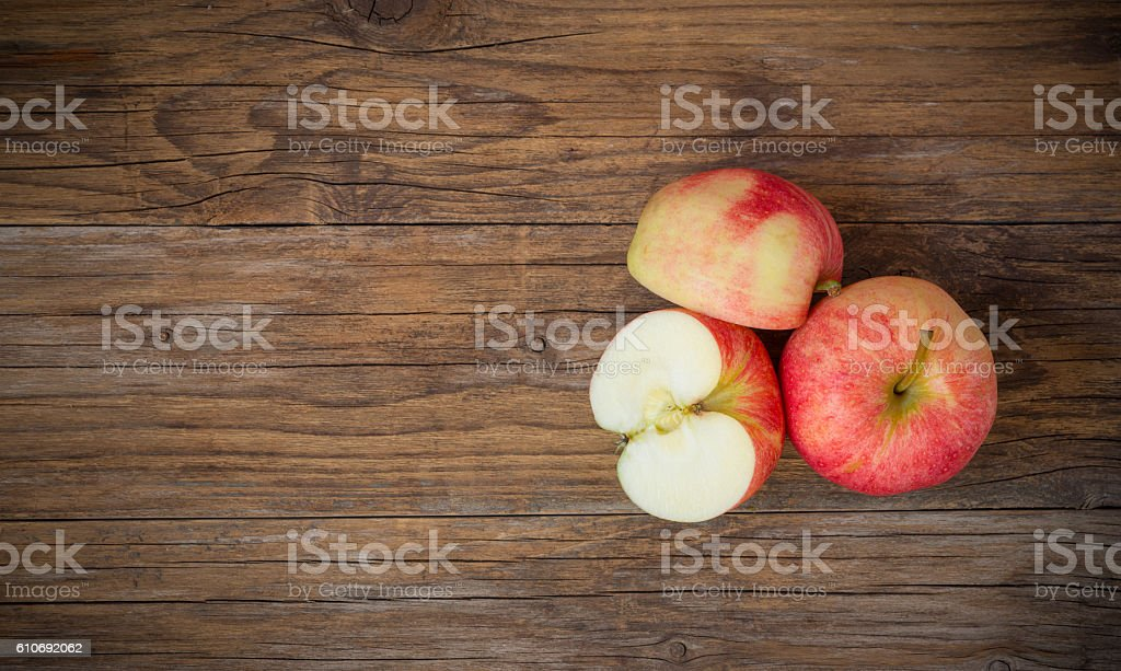 Apples sliced  on wooden table stock photo