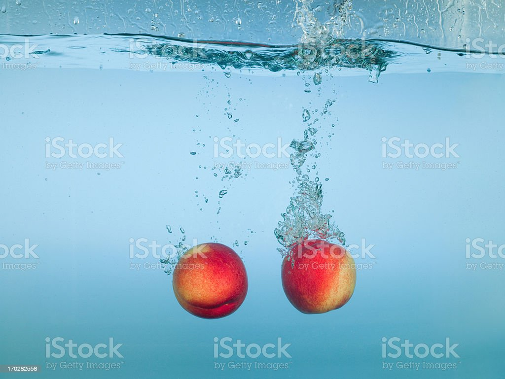 Apples splashing in water stock photo