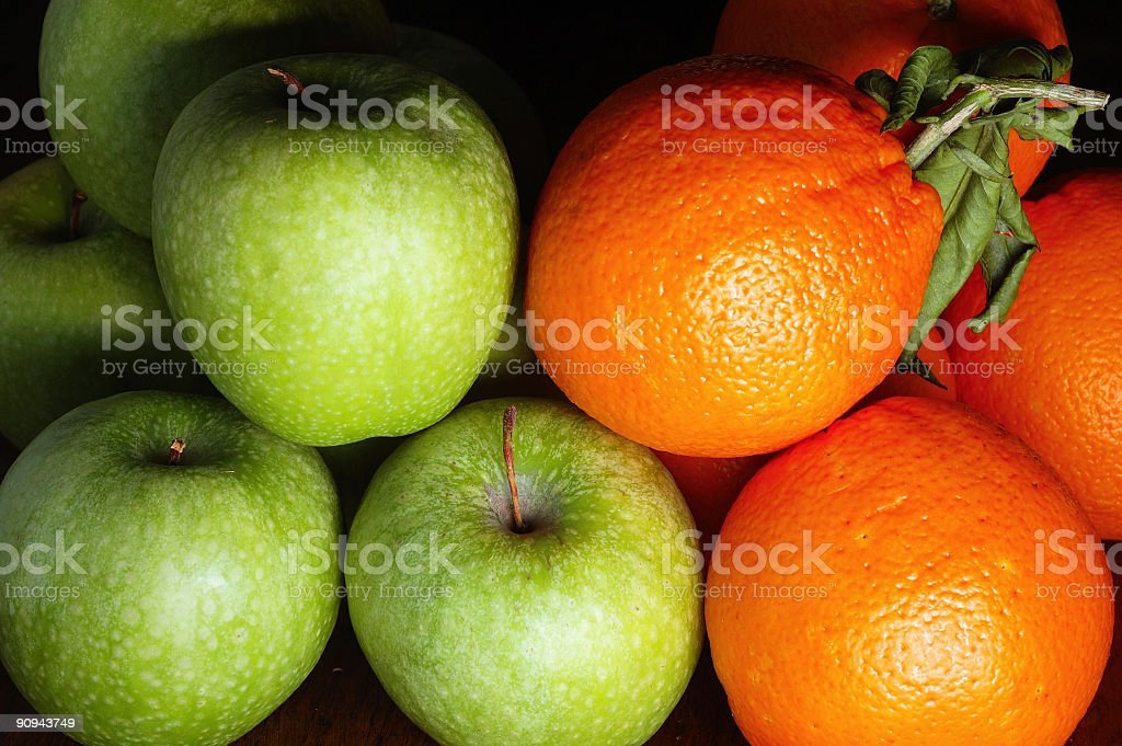 Apples v Oranges stock photo