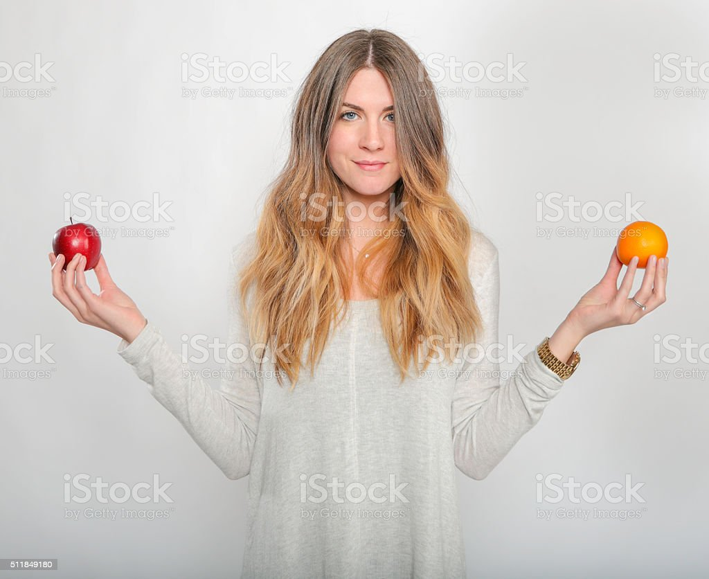 Apples vs Oranges stock photo