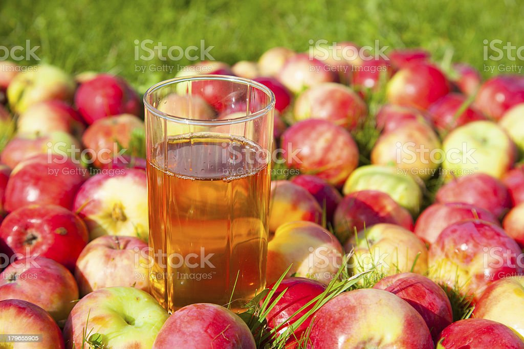 Apples with a glass of juice royalty-free stock photo