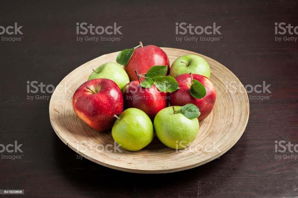 apples. with lives. wooden background