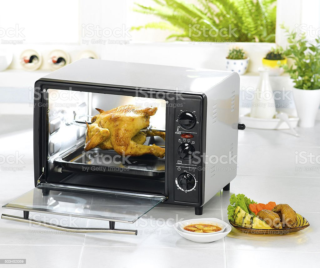 Appliance chicken roaster oven in the kitchen interior stock photo
