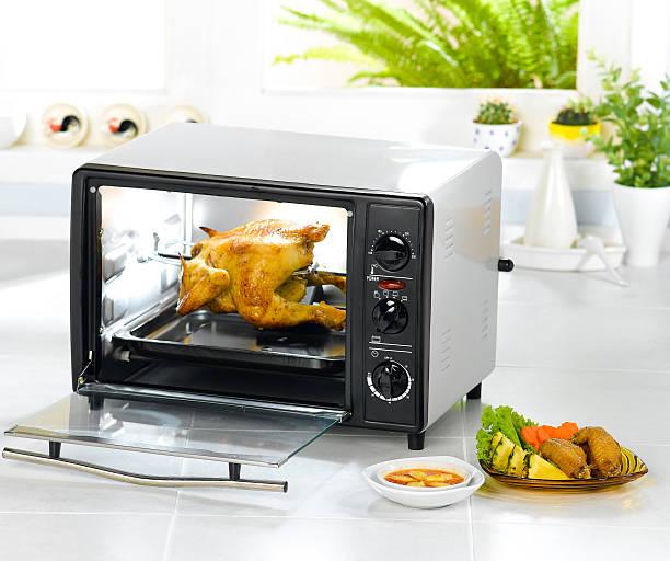 Appliance chicken roaster oven in the kitchen interior stock photo