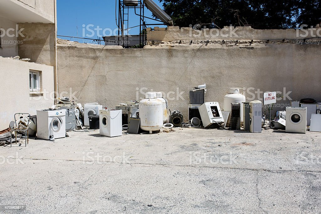 Appliances bump. Washing machines, boilers recycled. stock photo