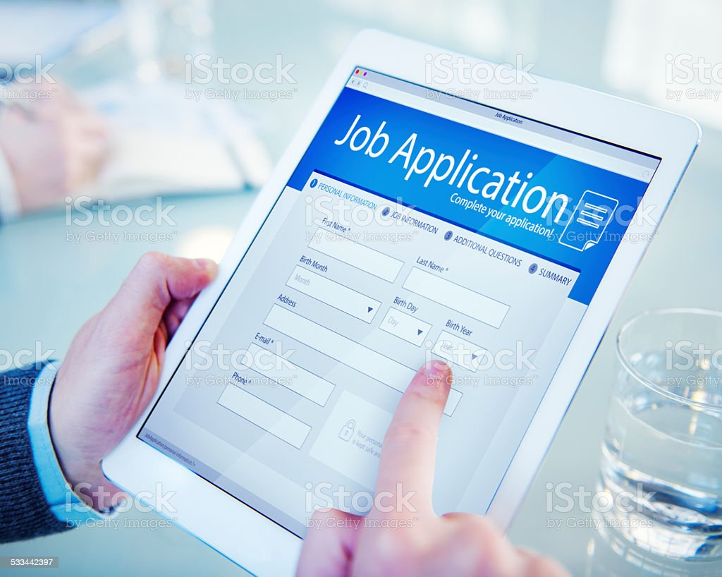 Applicant Filling Up the Online Job Application stock photo