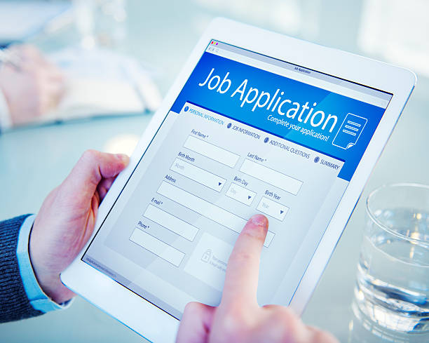 applicant filling up the online job application - apply online stock photos and pictures