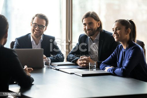 843963182 istock photo Applicant sitting in front happy HR businessmen and businesswoman speaking. 1208998518