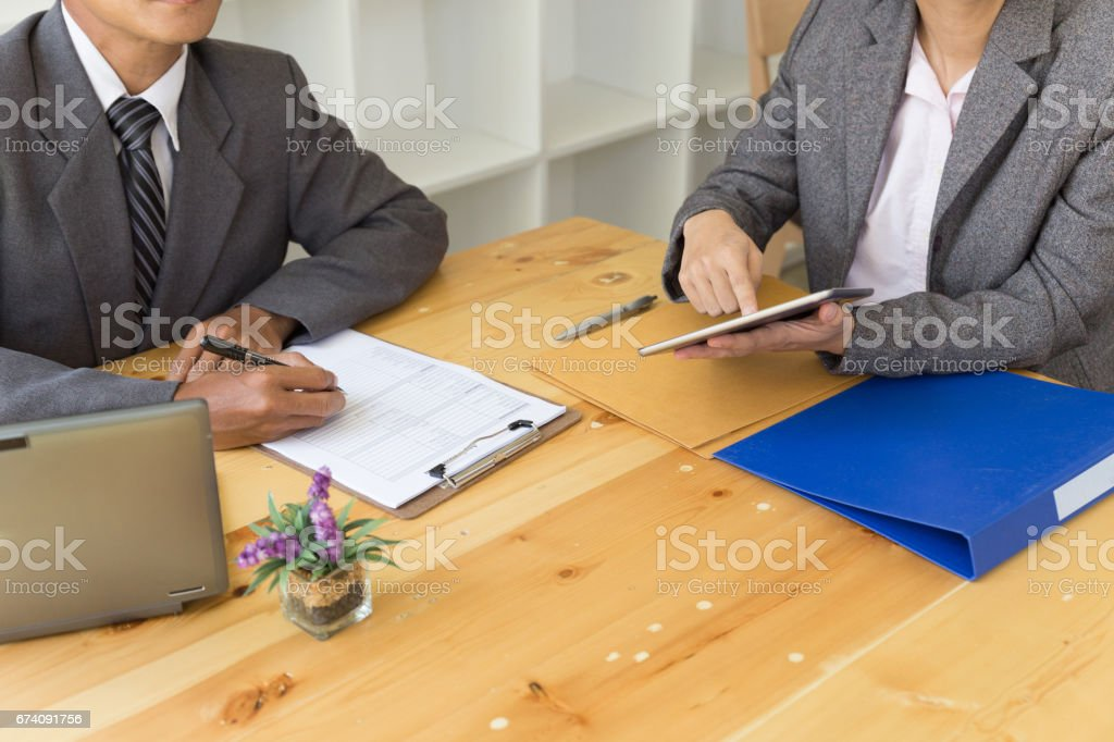 applicant's hand holding ballpoint pen writing on empty application form paper. Business person fill in blank document sheet applying job position, mortgage loan, registering registration information royalty-free stock photo